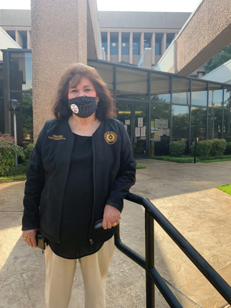 Terry Meza standing in front of City Hall in Irving, Texas, wearing a COVID-19 mask